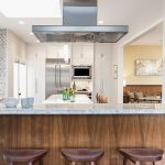 Redondo Beach modern coastal kitchen island seating with stainless steel exhaust fan above. Manhattan Beach modern coastal home.