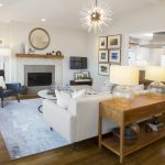 Redondo Beach Interior Designers modern coastal style living room with blue side chair and white sofa facing fireplace