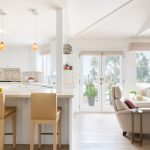 Beachy contemporary Manhattan Beach home with open concept warm neutral kitchen and living room